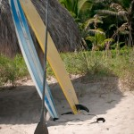 Paddle Surfboards leaning on the tiki hut in Delray Beach Florida