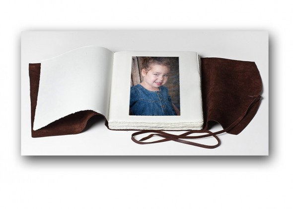 Fine Art Portfolio with fine art archival paper hand sewn in a soft leather binding