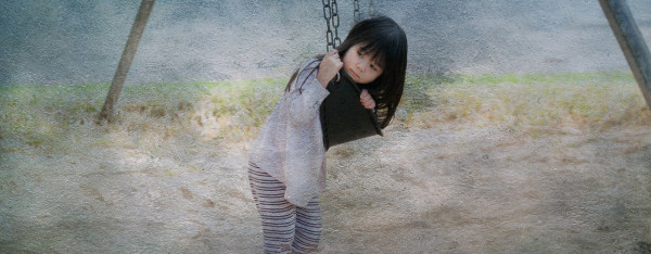 Portrait of young girl on a swing by Jacqueline Agentis